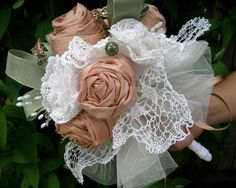 Florence - A Victorian Inspired Fabric Wedding Bouquet. Featuring peach silk cabbage roses. Nestled between is a selection of white vintage crocheted lace doilies.A must for any vintage or shabby chic bride!  I like all my bouquets to represent romantic sentiments and use the language of flowers as a basis. I also like to include a good luck charms as well.    Cost $245.00AUD
