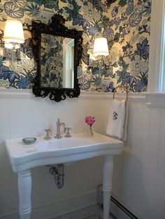 wainscoting / blue floral wallpaper