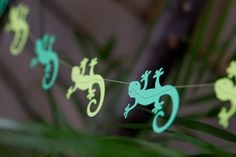 Cut out reptile shapes and sew a garland with a sewing machine. Cute!