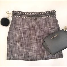 Host Pick  Tweed Skirt Discounted Bundles ▪️Please use the offer feature  ▪️Ships within 24 hours ✈️ ▪️No tradesNo Paypal ▪️ Love the item but not the price?  Make an offer!  ▪️Questions?  Don't be shy!  Feel free to ask  ▪️Condition - NWT ▪️Size - 4 ▪️Material - Cotton ▪️Description - Beautiful tweed skirt with back zipper closure and beaded and zipper detail along waistband.  Invisible zipper closure in the back.  Measures about 14.5 inches from waistband to hemline. H&M Skirts Mini
