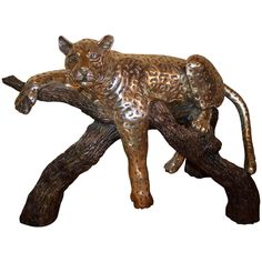 D'argenta Large Silver Plated Ricardo Del Rio Bronze Leopard | From a unique collection of antique and modern sculptures at https://www.1stdibs.com/furniture/decorative-objects/sculptures/