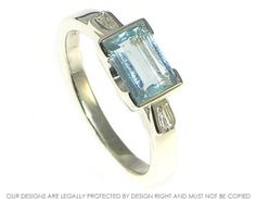 Art deco style 9ct white gold engagement ring with a 0.94ct aquamarine and diamonds