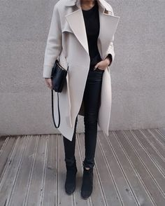 stone coat, black top, leather pants & boots