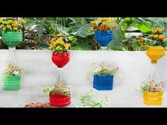DIY - My garden design ideas - Great ideas for making wall flower pots from plastic bottles - YouTube Plastic Bottle Planter, Plastic Flower Pots, Plastic Bottle Crafts, Plastic Bottles, Container Herb Garden, Herb Planters, Planter Pots, Herb Garden Design, Garden Deco
