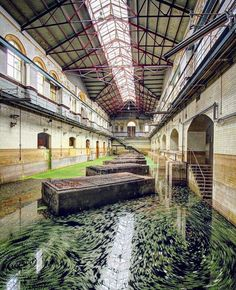 'This is the swirling surface of algae rich flood water in the now abandoned C Station at Abbey Mills Station in East London'