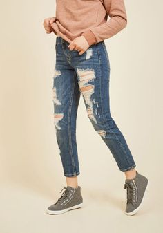 "Is it too soon to sport these distressed jeans again? We say, ""never!"" With a mid wash and stylish shredding, these casual skinnies make routine appearances at concerts, bike rides, and Friday dive bar adventures."