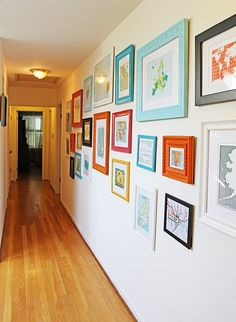 "Inspiring gallery wall!! Love the color combo. Krylon spray paint, to be exact. Pumpkin Orange, Blue Ocean Breeze, Raspberry, Black, White and a couple other ""complementary"" colors. Cheap frames, bought all sorts of maps from Etsy sellers"