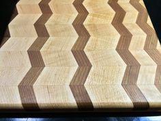 Our chevron herringbone design cutting board made with walnut, oak and cherry hardwoods.  $175.00 Chevron, Pattern Cutting, Wood Glass, Herringbone Pattern, Butcher Block Cutting Board, Animal Print Rug, Woodworking, Rugs, Projects