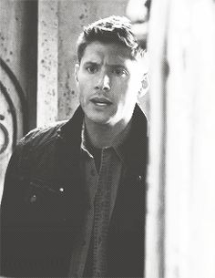 Dean getting sprayed with holy water.