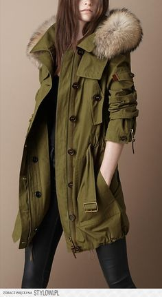 olive overcoat with fur, bold style, plenty of angles, pushed up sleeves creates texture