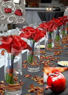 Great table decor! With white lilies in the vases and red rose petals on the table. Simple