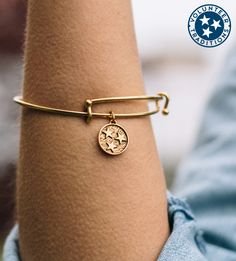 - HANDCRAFTED IN AMERICA - 22 Karat yellow gold plated & sterling silver bracelet with a light antique wash - 1/2 inch tristar charm - Adjustable - Super cute