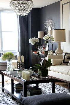 dark grey walls mixed with light upholstery