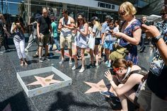 Los Angeles based Street artist Plastic Jesus build mini, barbed-wire wall around Donald Trump's star on the Hollywood Walk of Fame.