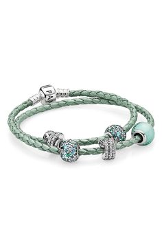 Add a splash of colour to your collection with PANDORA's leather bracelet in this year's standout shade: mint green. The metallic finish creates a feminine and stylish look that will enhance any summer outfit. Style it with stunning charms from the new collection for the perfect exotic feel. Soon in stores. #PANDORA #PANDORAbracelet #Summer2015