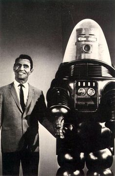 "That's Rod Serling of ""Twilight Zone"" fame. Is his companion ""Robby"" from the Movie ""Forbidden Planet""? Robby the Robot was used in an episode titled, ""Uncle Simon"" in Note he was altered somewhat to give him a wee bit of a human face. Sci Fi Tv, Sci Fi Movies, Movie Tv, Scary Movies, Futurama, Quatrième Dimension, Cyberpunk, Science Fiction, Robby The Robot"