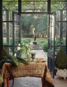 sunroom with steel doors and windows, brick floor, potted topiaries, gorgeous garden view - Louisana Plantation Home by Steichen Interior Design Outdoor Rooms, Outdoor Gardens, Outdoor Living, Indoor Outdoor, Patio Interior, Interior And Exterior, Interior Design, Magic Places, Steel Doors And Windows