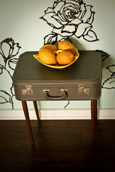 the most clever idea I've seen in a long time- vintage suitcase furniture  i also love the painted roses on the wall