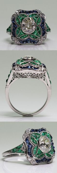 An Art Deco platinum, diamond, sapphire and emerald ring, 1920-35.