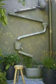 Een regenpijp, aanvoer van regenwater