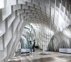 Architecture firm sculpts hanging fiber-glass shapes to create one unbelievable ceiling at the SND Concept Store in Chongqing, China. Design Commercial, Commercial Interiors, Boutique Interior Design, Interior Design Magazine, Modegeschäft Design, Path Design, Design Blogs, Design Trends, Modern Design