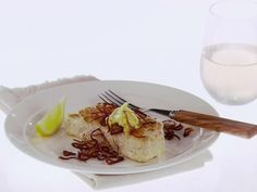 Get Giada De Laurentiis's Halibut with Lemon-Butter and Crispy Shallots Recipe from Food Network