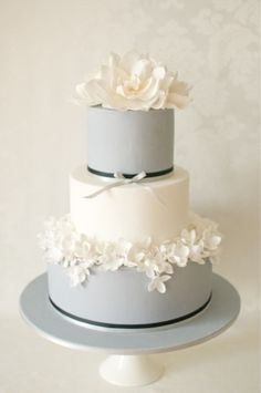 Gray and white wedding cake...just the flower on top would be perfect and without the black bows
