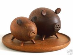Wooden salt and pepper pigs. My mom had these!