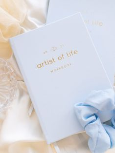 The 2021 Artist of Life Workbook is a guided journal to help you create your most intentional and meaningful year in 2021. With 150 pages of questions & exercises for self discovery, self love and life design, it's a tool to keep you inspired, motivated, and organized, taking you from where you are to where you want to be. This purchase includes a complimentary digital download of the 2021 Artist of Life Workbook (Digital) Interactive PDF. Are you ready for brighter days in 2021? NOTE: We wi
