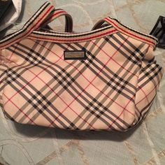 Authentic blue label Burberry bag Very vintage, inside lining is torn a little. Blue label fell off. Guarantee authentic. You can have it check.. Purse stills looks great little sign of wear. Burberry Bags