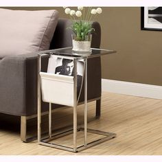 This modern end table will lend a unique design to your living space. With tempered glass and a sleek design, this accent table features a magazine holder for easy storage.