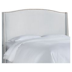 Upholstered wingback headboard with nailhead trim. Handmade in the USA with solid pine wood.   Product: Wingback headboard  ...