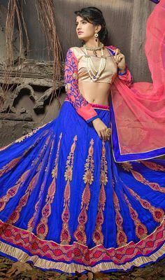 Look adorable in this blue embroidered net flared lehenga cholie. The ethnic lace, patch, resham and stones work to the attire adds a sign of magnificence statement for the look. #TraditionalLehengaCholi