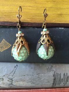A personal favorite from my Etsy shop https://www.etsy.com/listing/466641995/great-balls-of-green-vintage-assemblage
