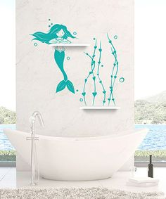 This mermaid swimming with heart-shaped seaweed adds aquatic interest to any wall, while the coordinated walnut shelves add practical storage. Easy installation makes for a masterpiece in moments.Includes two shelves, wall decal, squeegee applicator, installation instructions and a practice decalShelves: 14'' wideWall decal: approx. 35'' W x 36'' HShelves: woodWall decal: vinylRemovableMade in the USA