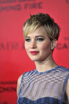 """Hollywood's """"It"""" Girl JLaw shocked her fans with an Instagram photo debuting her cropped 'do. We admit we were skeptical at first, but Jennifer quickly proved us wrong rocking her versatile cut in style-after-chic-style at the variousHunger Gamespremieres."""