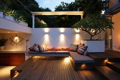 Outdoor entertaining area with built in furniture & great lighting.
