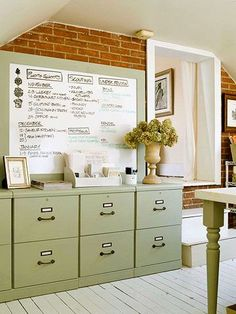 Taken from Better Homes and Gardens:  Using Wall Space -  What it is: Work board or work of art? You decide.    How to do it: Attach inexpensive molding to a dry erase board and paint to match the rest of your furnishings. Then, outline your plan to take over the world -- or at least organize the kids' sports practices.