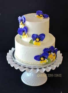 Small buttercream wedding cake with gum paste pansies