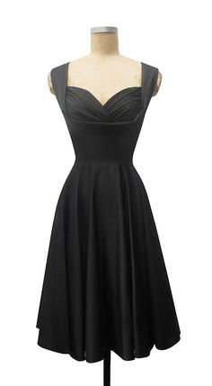 Black cocktail dress, sweetheart neckline Via Indulgy.Com