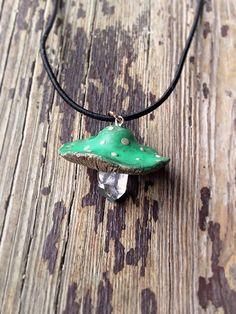 Green polymer clay mushroom pendant on a clear quartz crystal