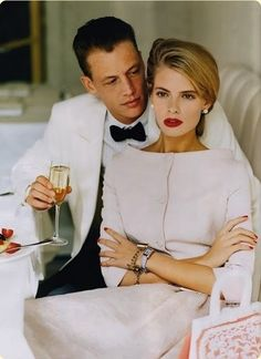 Fancy......What a gorgeous couple..I love a white tux...She's beautiful...My fave, red lipstick and nails ....classicHer outfit is just too pretty❤❤I want...