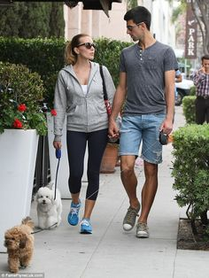 Doubles:Tennis star Novak Djokovic and wife Jelena Ristic enjoy romantic stroll with their pet pooches in West Hollywood