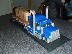 B-Train truck cake with working headlights. Truck is RK, the cake is the load on the trailer of the truck.