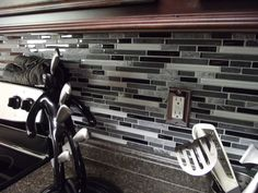 Anatolia Bliss Series Midnight Linear.  A perfect glass and stone blend of natural stone and black and white glass tiles.