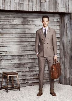 Something as simple as opting for a brown double breasted blazer and brown trousers can potentially set you apart from the crowd. Mix things up by wearing dark brown suede dress boots.   Shop this look on Lookastic: https://lookastic.com/men/looks/double-breasted-blazer-dress-shirt-dress-pants/18642   — Light Violet Dress Shirt  — Dark Brown Tie  — Brown Double Breasted Blazer  — Brown Dress Pants  — Tobacco Leather Briefcase  — Dark Brown Suede Dress Boots