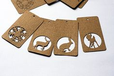 Love this idea for cut-outs - Holiday cards? Craft ecru kraft cardboard paper hang tags : deer, rabbit, fawn, snowflake