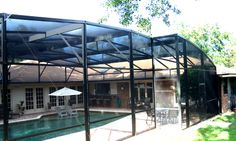 'Dome' style aluminum screen enclosure by Design Pro Screens. Call today for all your Central Florida Pool enclosure needs & repair services!  407-339-1090. www.designproscreensinc.com