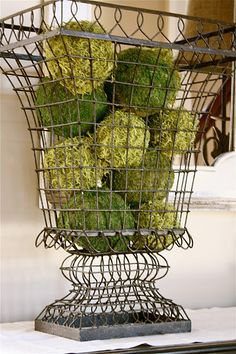 Wire basket/ shelf DIY for moss covered styrofoam balls. The Yellow Cape Cod: Client Project~Foyer~Before and After Pot Pourri, Styrofoam Ball, Wire Baskets, Wire Basket Decor, Decoration Table, House Decorations, French Country Decorating, Plant Hanger, Farmhouse Decor