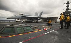 F/A-18E Super Hornet from the Gladiators of Strike Fighter Squadron (VFA) 106 prepares to launch from the flight deck of the aircraft carrier USS George Washington (CVN 73).